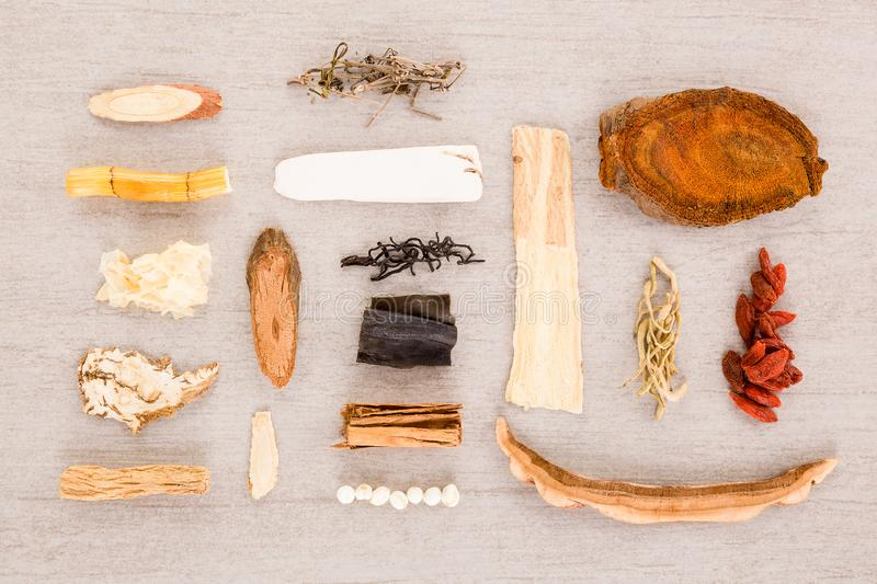 Traditional chinese herb ingredients used in alternative herbal medicine. Traditional chinese medicine knolled together from above stock photo