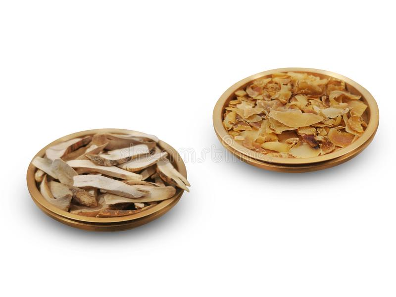 Traditional Chinese herbs series. Astragalus and dried korean red ginseng on white stock photos