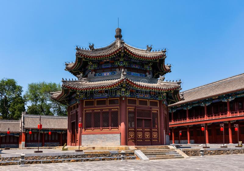 Traditional Chinese imperial pavilion under blue sky. With red lanterns at Yuanmingyuan the Old Summer Palace, Beijing royalty free stock photo