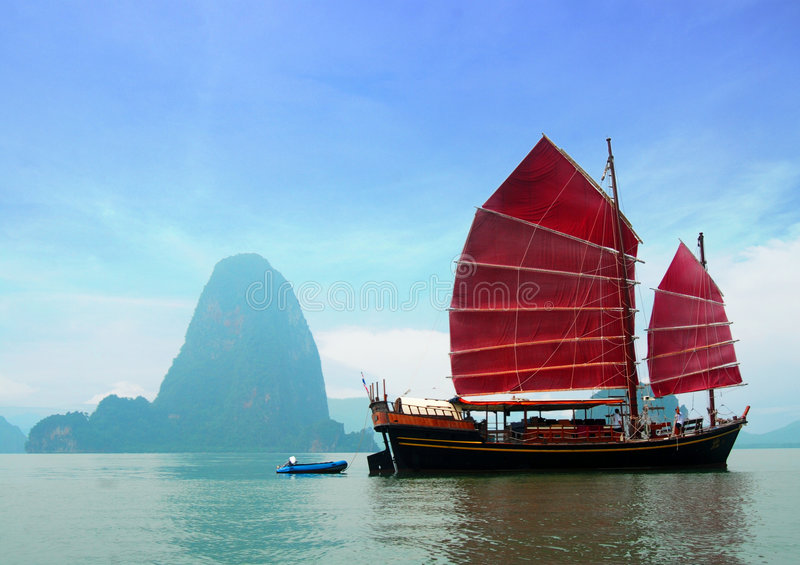 Traditional Chinese June. Traditional June Bahtra red Chinese junk cruise ship in Phang Nga Bay, Phuket, Thailand