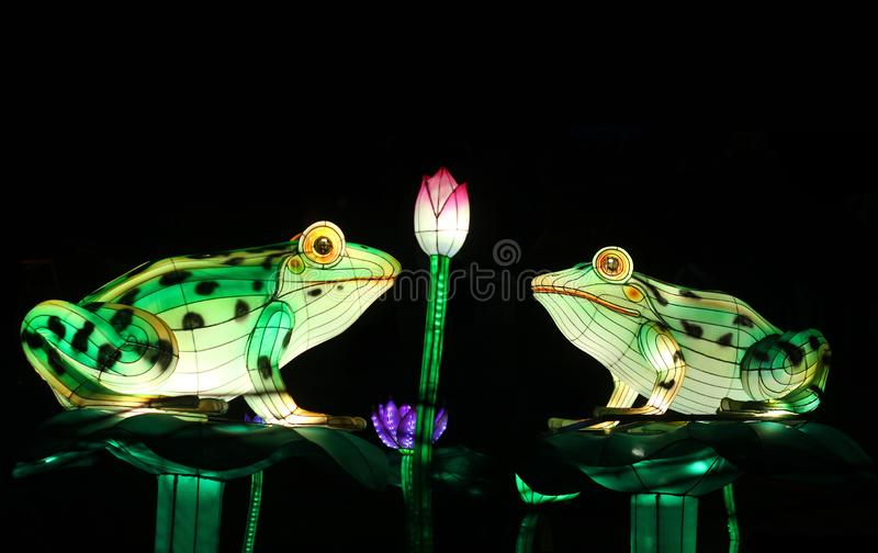 Traditional chinese lanterns in the shape of frogs on pond stock images