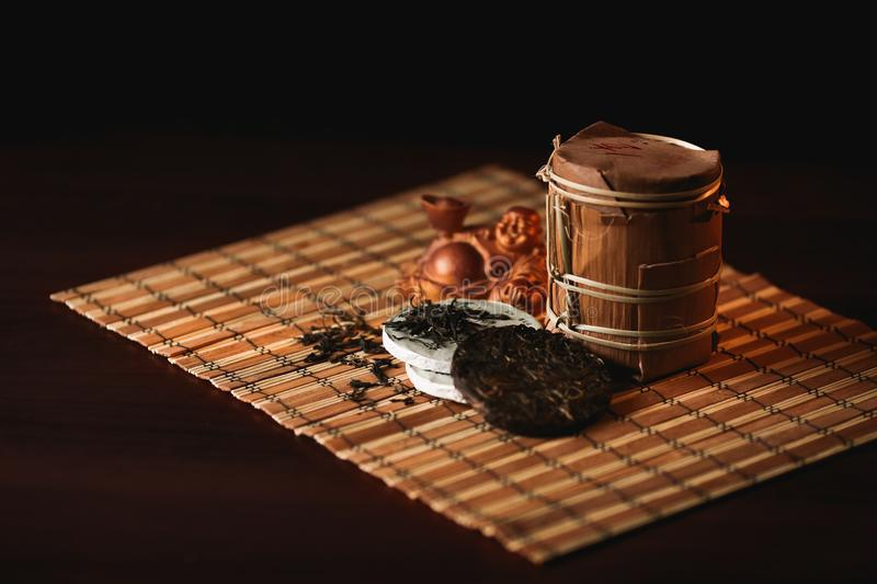 Traditional Chinese puer tea with golden frog on a bamboo mat. stock photography