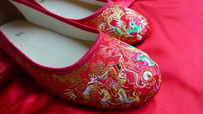 Traditional Chinese red bridal shoes royalty free stock image