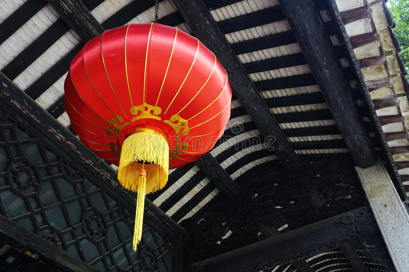 Chinese red lantern China. Decorative light. Traditional Asian Chinese red lantern lamp with classical design hanging from eaves of house for outdoor landscape royalty free stock photos
