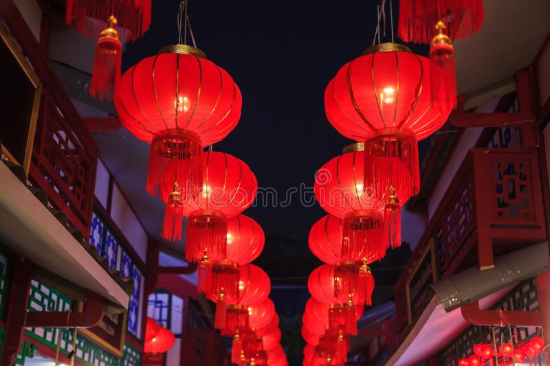 Traditional Chinese Red Night Outdoor Vintage Hanging Pendant Light Lanterns with golden tassels decoration adorning street lights stock photo
