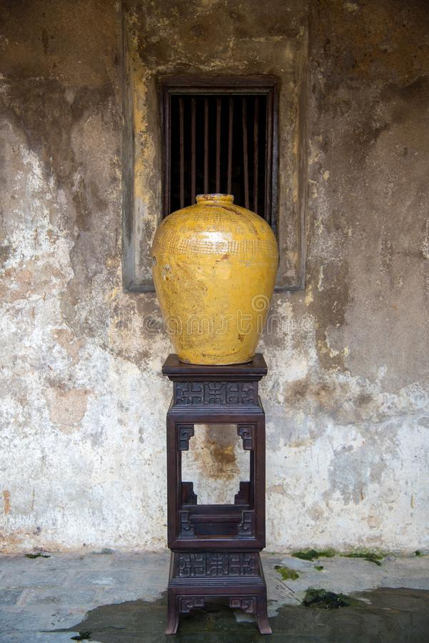 Traditional Chinese rice wine jars for liquor fermentation on vintage tabel at thailand , old jar.  stock image