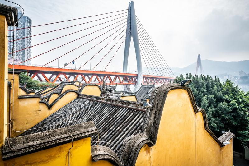 Traditional Chinese roofs and yellow walls at the Huguang huiguan Guild Hall and bridge view Chongqing China. Traditional Chinese roofs and yellow walls at the stock image
