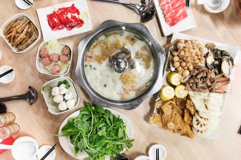 Traditional Chinese steamboat or hotpot with delicious food spread royalty free stock image