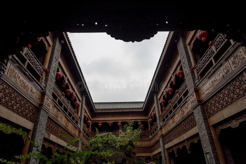Traditional chinese style building with overcast sky. Traditional chiense style building with beautiful wooden patterns decorantion under overcast sky royalty free stock photography