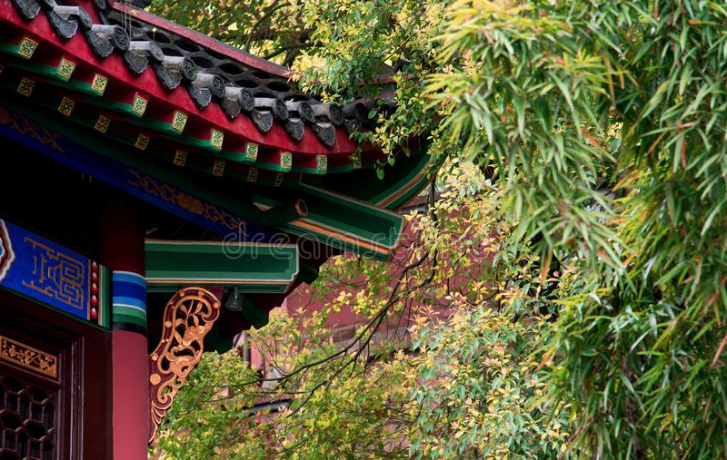 Traditional chinese style pavilion details. Closeup of traditional chinese style pavilion details with bamboos and trees royalty free stock images