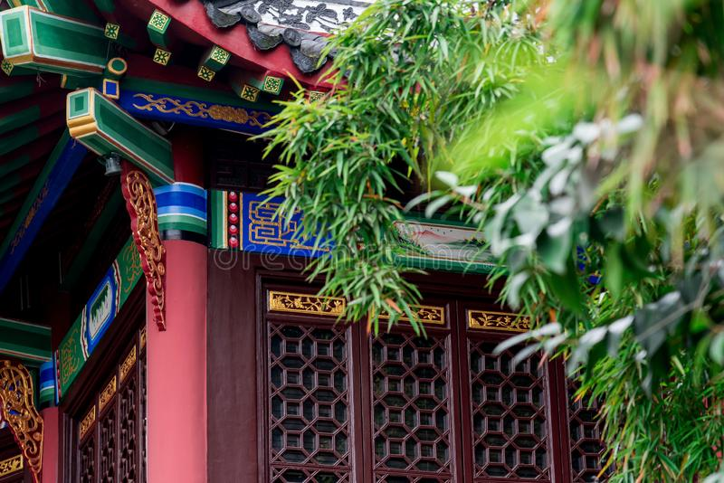 Traditional chinese style pavilion details. Closeup of traditional chinese style pavilion details with bamboos and trees royalty free stock photo