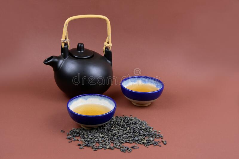 Ceramic teapot with cup stock images stock photos