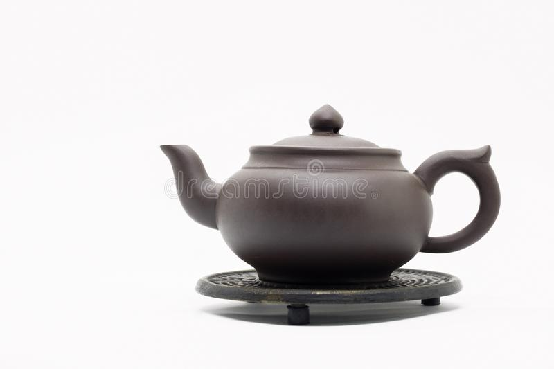 Traditional Chinese teapot made of Issinclay clay, tea ceremonion, isolated on a white background royalty free stock image