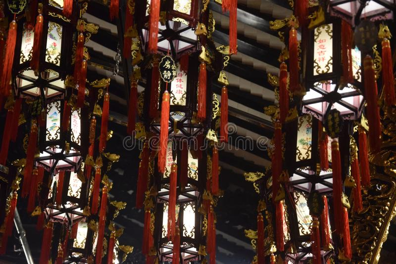 The traditional chinese wooden lanterns suspended inside the taoist temple. Canton, China. The traditional chinese wooden lanterns suspended inside the taoist royalty free stock photos