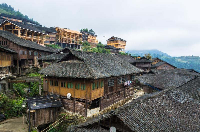 Traditional chinese Zhuang Long Ji minority village wooden houses. LONGSHENG, CHINA - October 19, 2013: Traditional chinese Zhuang Long Ji minority village stock photos