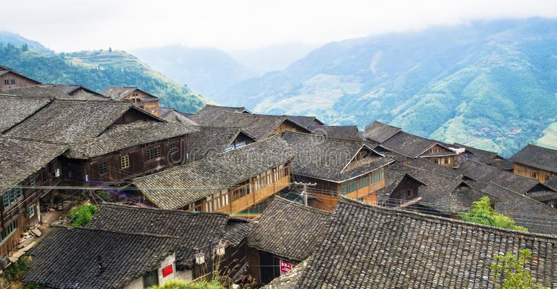 Traditional chinese Zhuang Long Ji minority village wooden houses. LONGSHENG, CHINA - October 19, 2013: Traditional chinese Zhuang Long Ji minority village royalty free stock photography