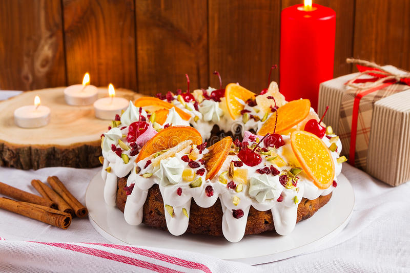 Traditional Christmas Cake. With holiday background. Decorated bundt cake. Shallow focus royalty free stock photos