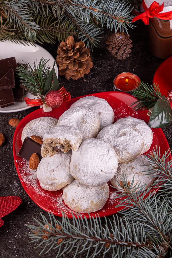 Traditional Christmas cookies biscuits snowballs covered icing sugar povder with almond nut, nutella chocolate an raspberry jam. Christmas New Year ornament stock image