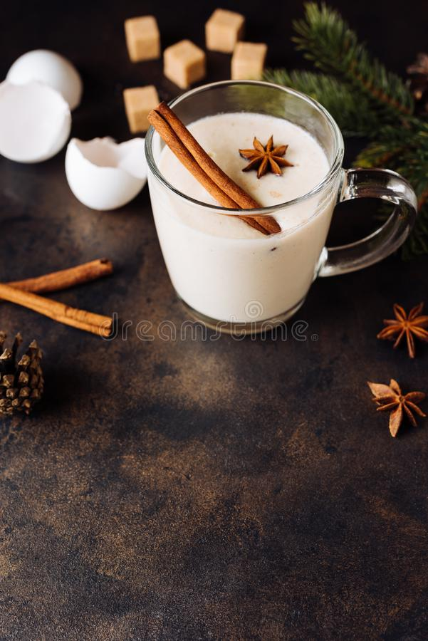 Traditional Christmas drink eggnog with cinnamon, anise stars stock images