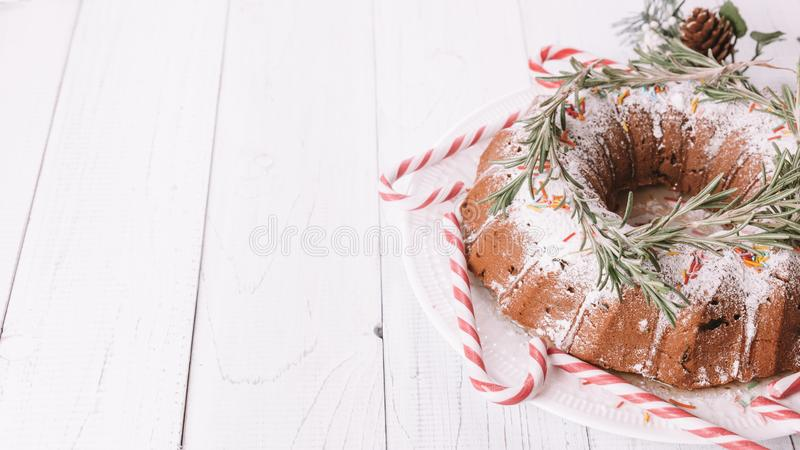 Traditional Christmas fruit cake on a white wooden table royalty free stock photography