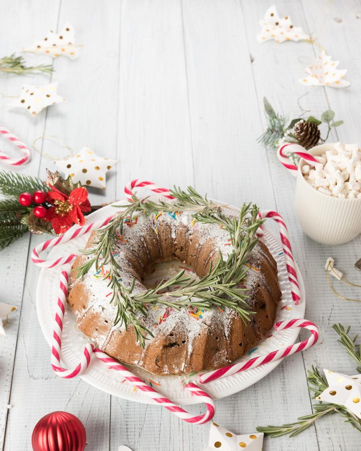 Traditional Christmas fruitcake on a wooden table. stock photos