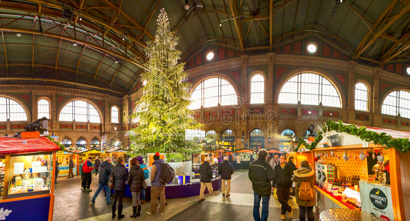 Traditional Christmas market with chrismast tree in Zurich, Switzerland. Traditional Christmas market in Zurich railway station with famous Swarovski christmas royalty free stock photos