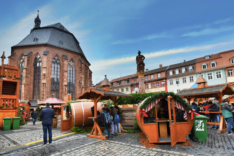 Traditional Christmas market in front of Church of the Holy Spirit called `Heiliggeistkirche` in German at marketplace stock images