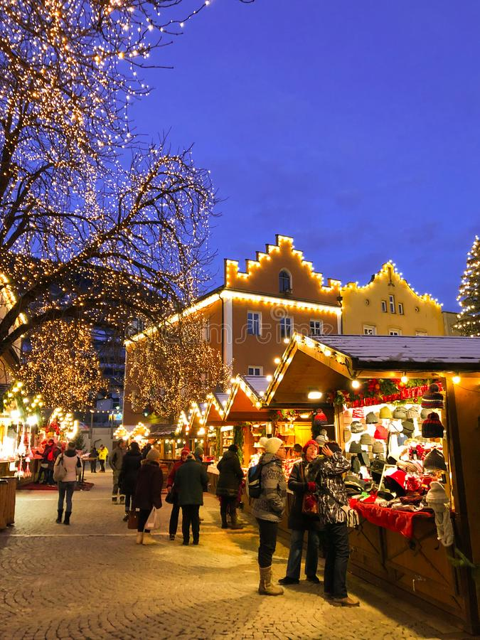 Traditional christmas market in the main square of Vipiteno Sterzing at night, Alto Adige. Italy stock image