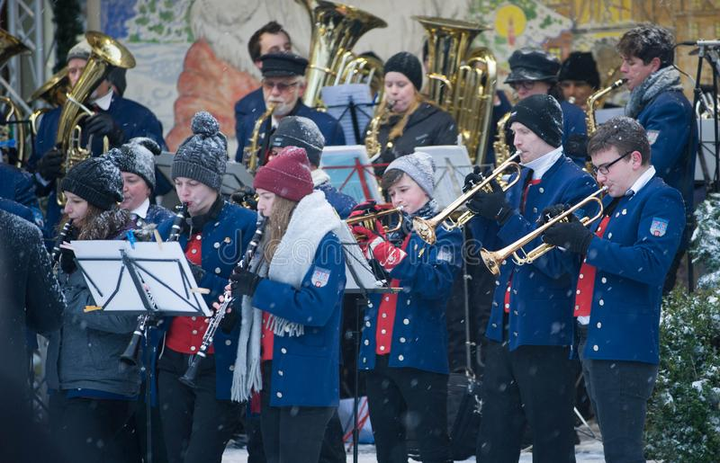 Traditional Christmas Market in Niederstetten and Local Orchestra Playing Christmas Songs. stock photo