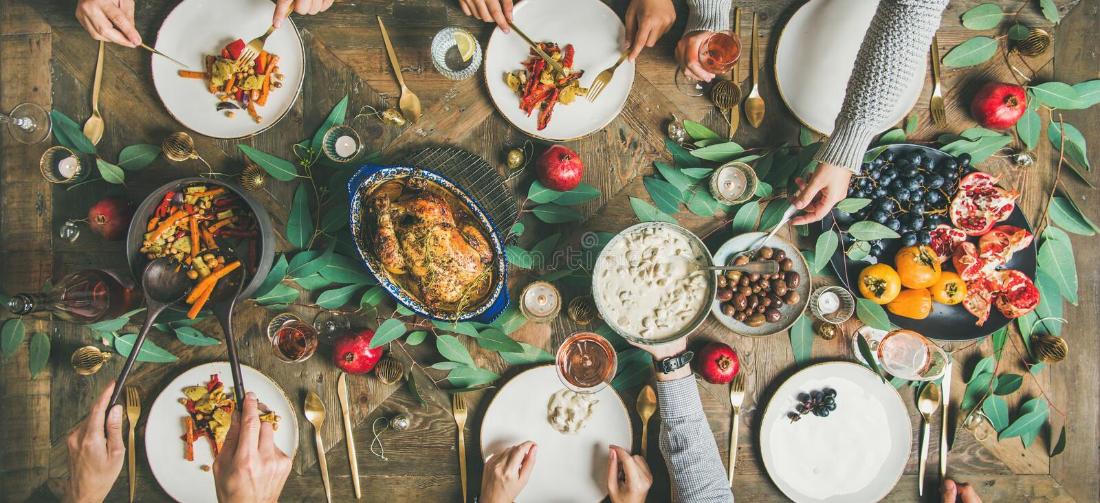 Traditional Christmas, New Year holiday celebration party dinner, wide composition royalty free stock photo
