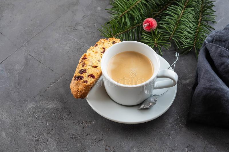 Traditional Christmas pastries, Italian homemade double-baked biscotti or cantuccini cake with coffee, with nuts and royalty free stock image