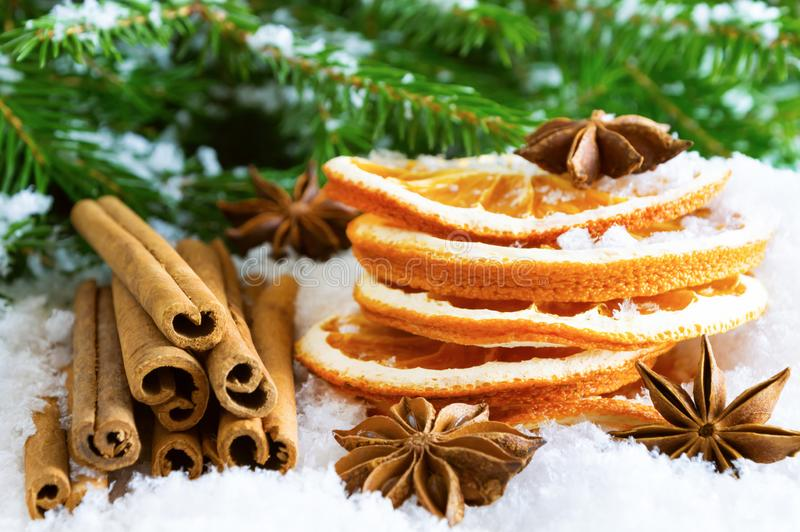 Traditional Christmas spices and dried oranges on the snow royalty free stock images