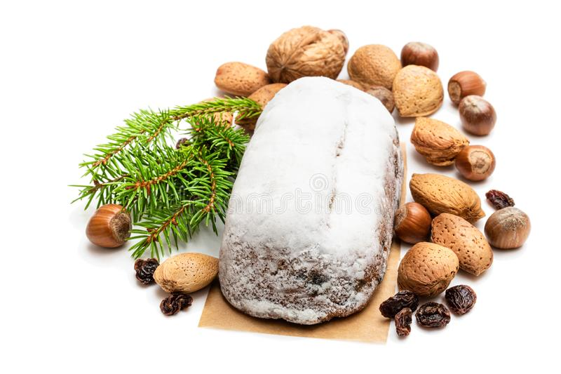 Traditional Christmas stollen fruit cake isolated on white stock images