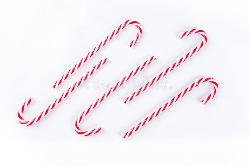 Christmas candy cane sweets. Traditional christmas sweets, candy cane sweets on white background, simple pattern, layout, on white background, top view stock photography