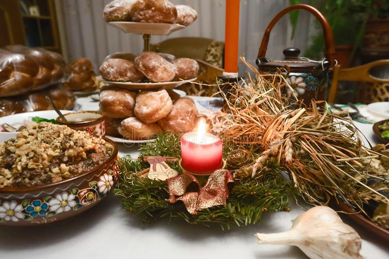 Traditional Christmas table in Ukraine, twelve meatless dishes, burning candle. family dinner. selective focus royalty free stock photos