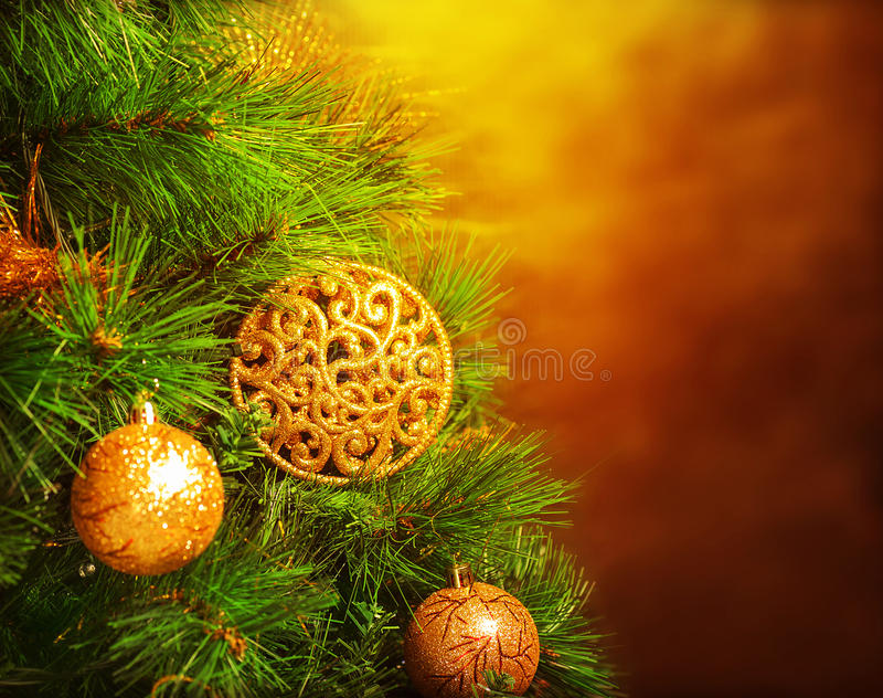 Traditional Christmas tree. Photo of traditional Christmas tree on brown grunge background, green fir decorated with golden bubbles toy, happy New Year greeting stock photography