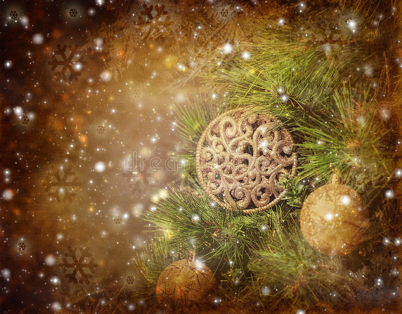 Traditional Christmas tree. Photo of traditional Christmas tree on brown grunge background, green fir decorated with golden bubbles toy, happy New Year greeting royalty free stock photo