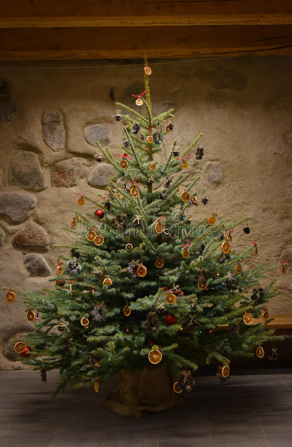 Traditional Christmas tree. Decorated with natural decorations, old-fashioned style stock photo