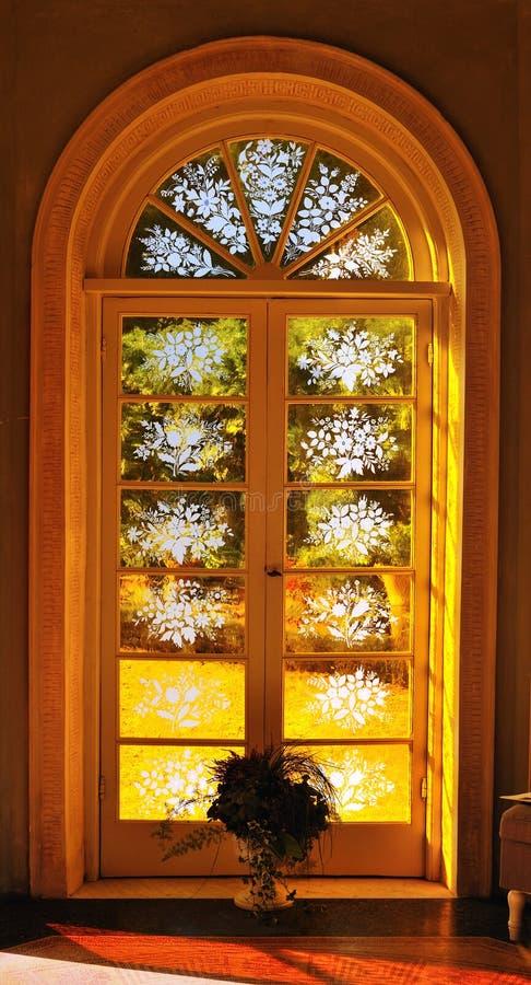 Classic windows door in interior with sun lights. Traditional classic windows door in interior with sun lights royalty free stock photos
