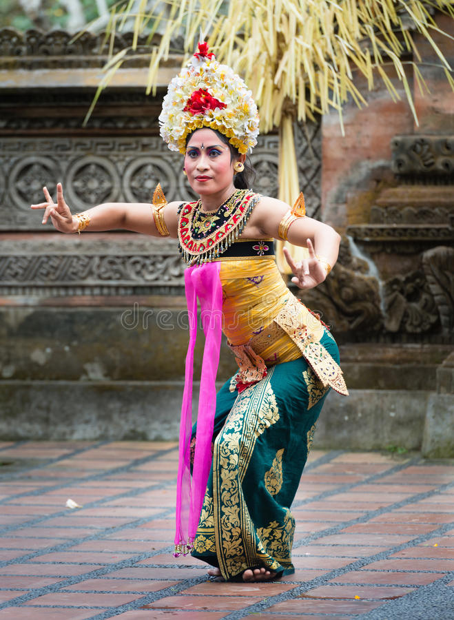 Traditional classical Legong dance on Bali. UBUD, BALI, INDONESIA - SEP 21: Unidentified woman performs Legong dance, the traditionala form of Balinese dance on stock image