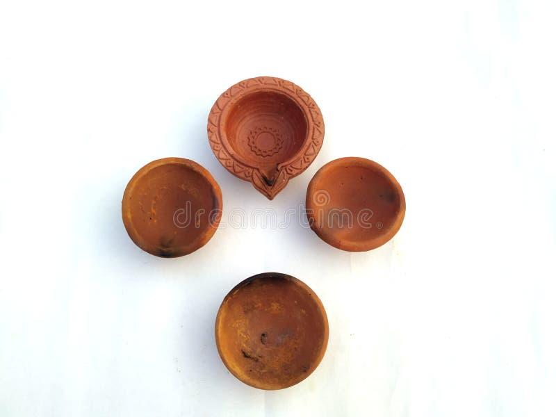 Traditional clay diya lamps lit during diwali celebration. Image of Traditional clay diya lamps lit during diwali celebration royalty free stock images