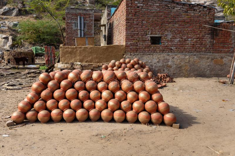 Traditional clay pots near house in Amber village. India. Traditional clay water pots near house in Amber village. India stock image