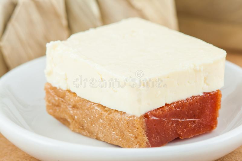 Traditional Colombian sweet called Bocadillo served with cheese stock image