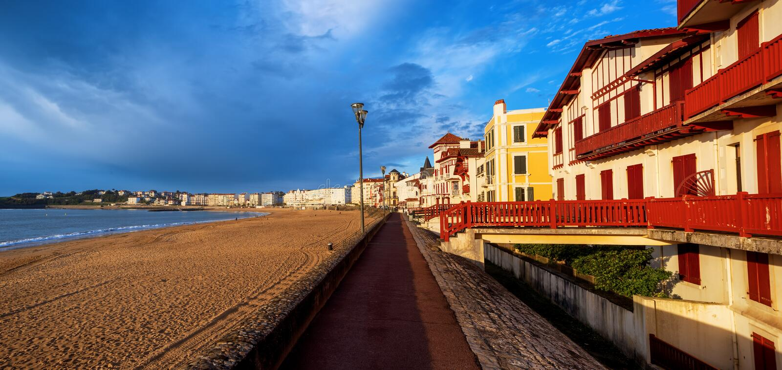 St Jean de Luz, sea side sand beach, France. Traditional colorful basque timber houses facing the sand beach in St Jean de Luz, Atlantic ocean coast, France royalty free stock photos