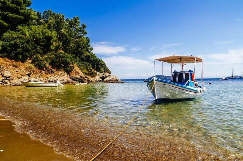 Traditional colorful boats in old town of Skiathos island, Sporades, Greece. Scenic view of aegean sea. Popular summer holiday destination scene stock photos