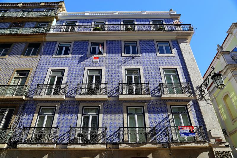 Traditional colorful buildings with azulejo tiles facade in the old Lisbon neighborhoods. Portugal stock images