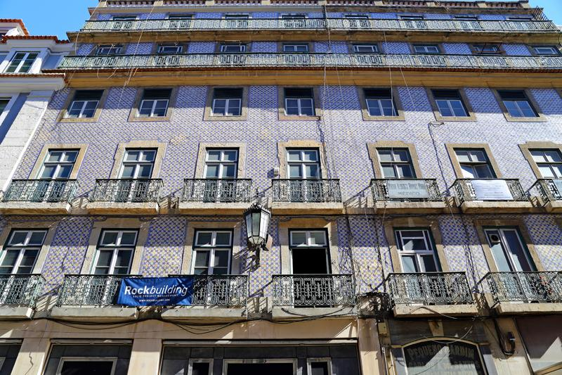 Traditional colorful buildings with azulejo tiles facade in the old Lisbon neighborhoods. Portugal stock image