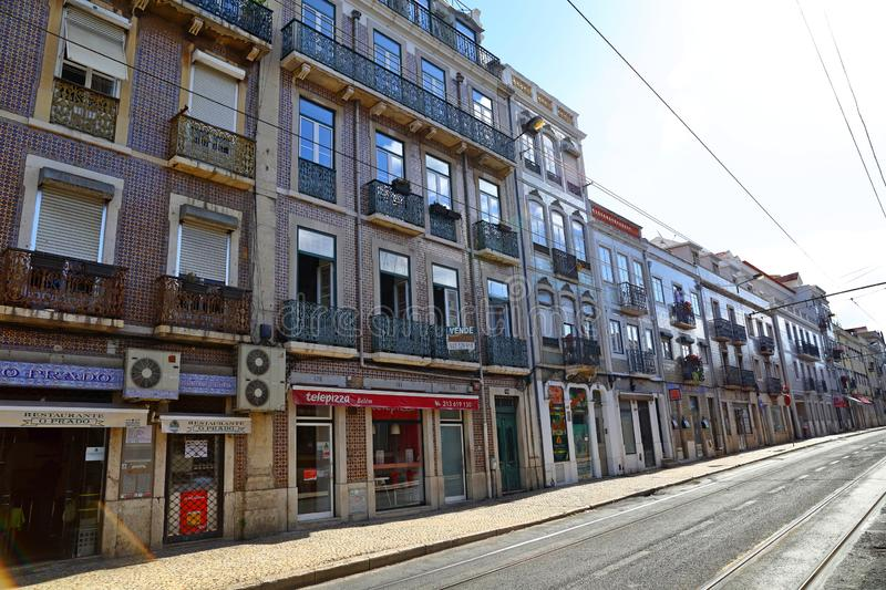 Traditional colorful buildings with azulejo tiles facade in the old Lisbon neighborhoods. Portugal royalty free stock photo