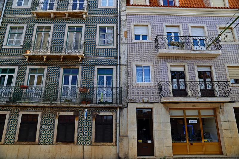 Traditional colorful buildings with azulejo tiles facade in the old Lisbon neighborhoods. Portugal royalty free stock images