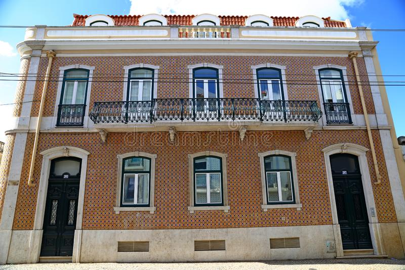 Traditional colorful buildings with azulejo tiles facade in the old Lisbon neighborhoods. Portugal stock photography